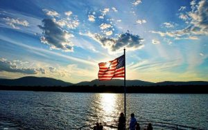 sunset and flag over lake george