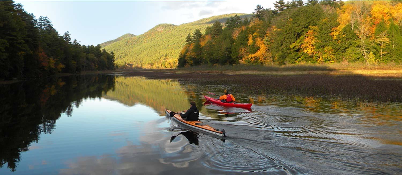 two kayakers cruise lake george