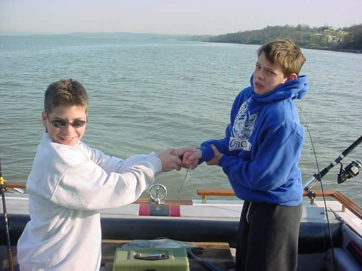 two boys fooling around with minnow