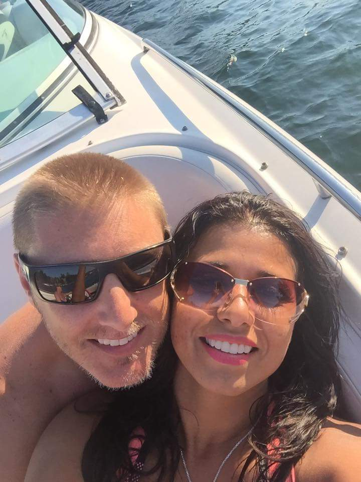 couple takes selfie on boat