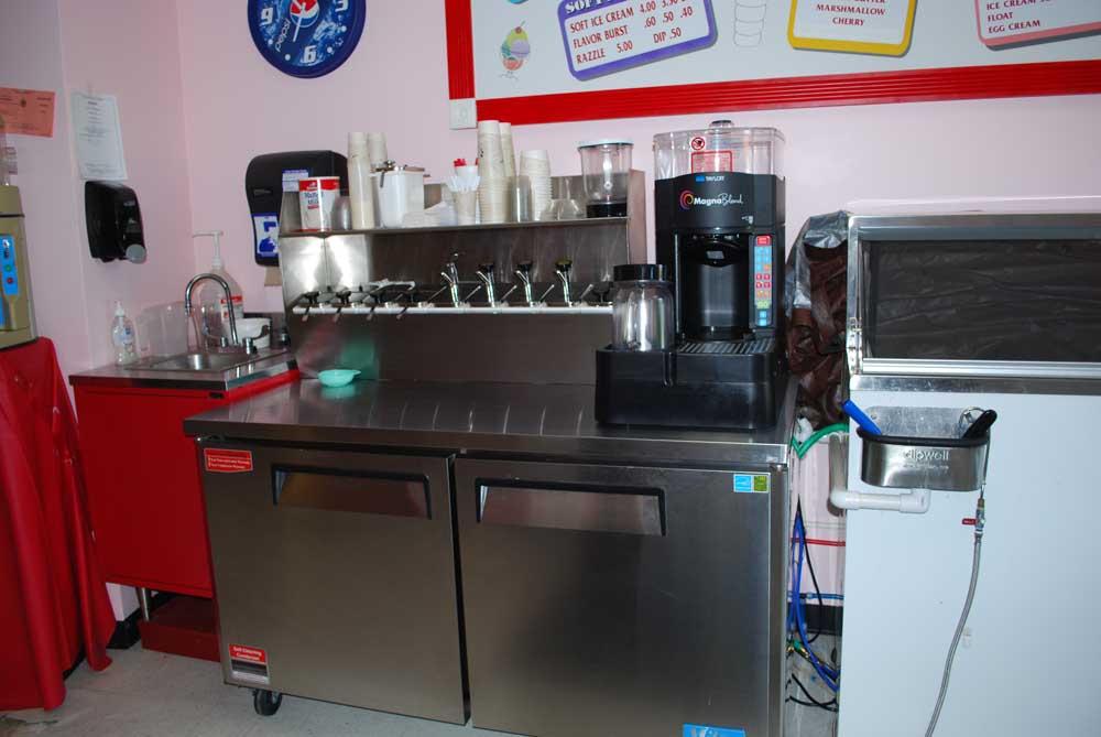 ice cream machine behind counter