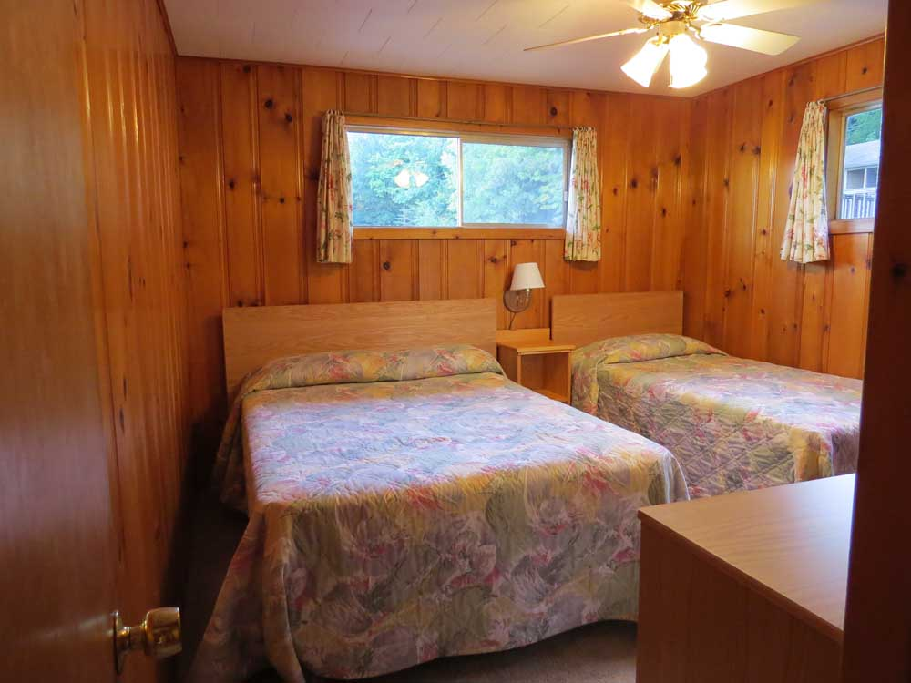 Wood Paneled Room with 2 Beds