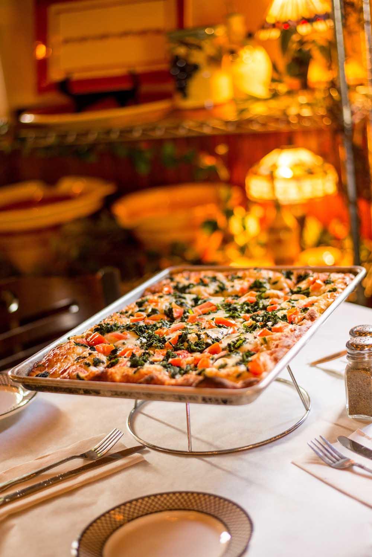 flatbread pizza entree on table
