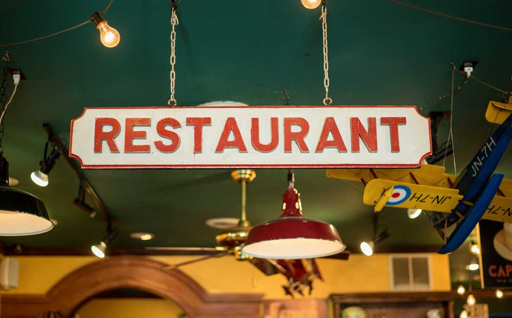 hanging sign that says restaurant