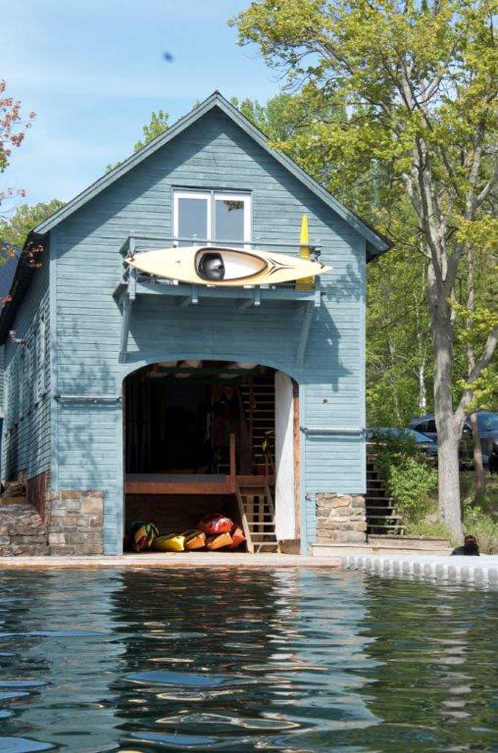 blue boat house on shoreline