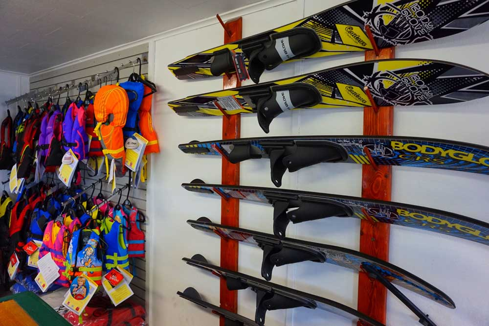 water skis and life preservers on wall