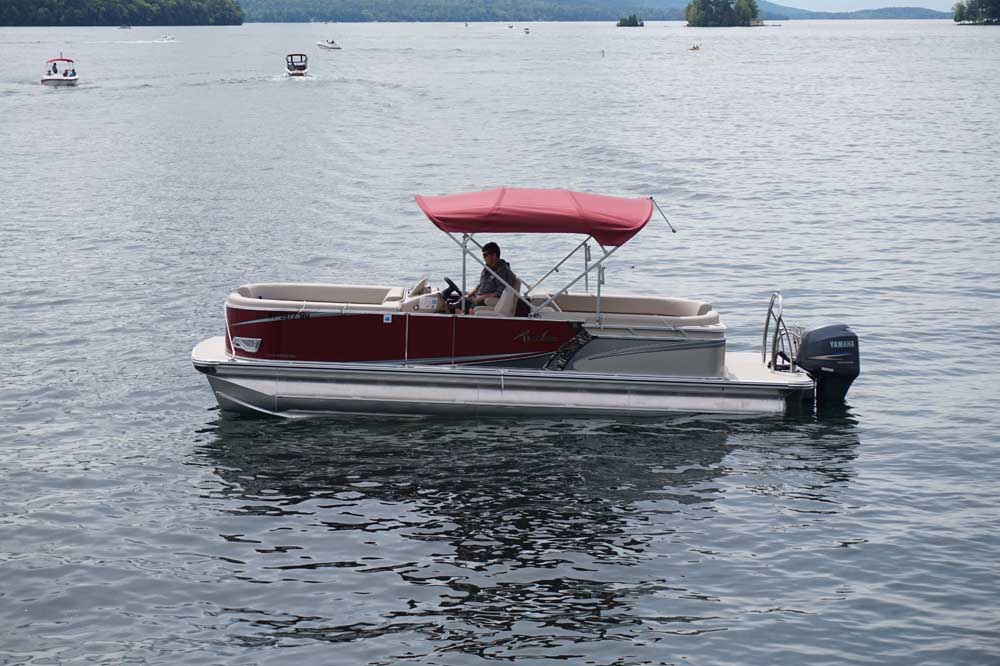 boat with red roof on lake george