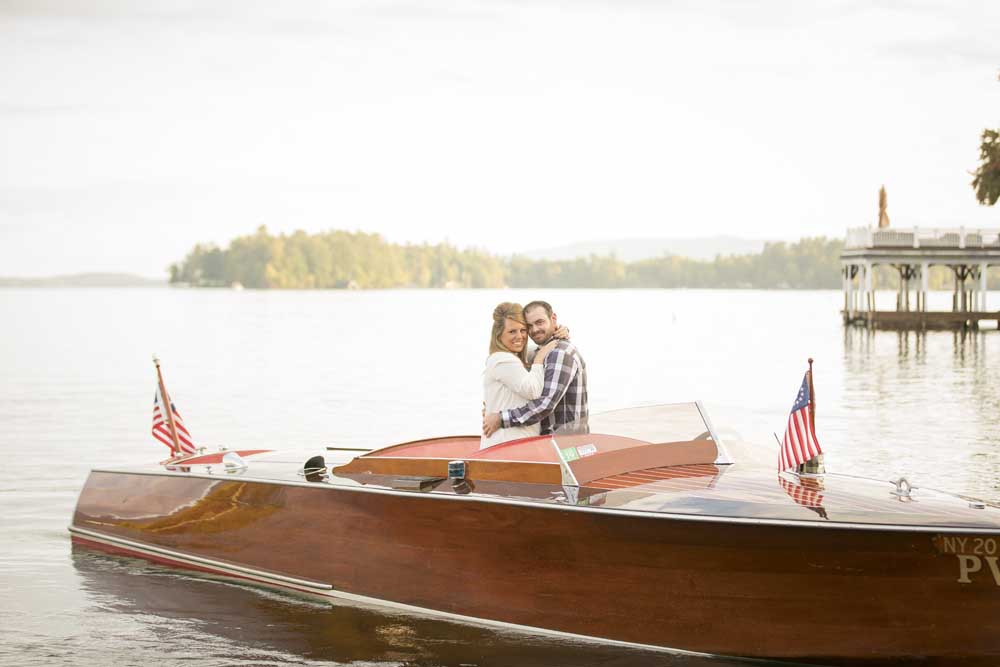 man and woman embracing on wooden boat