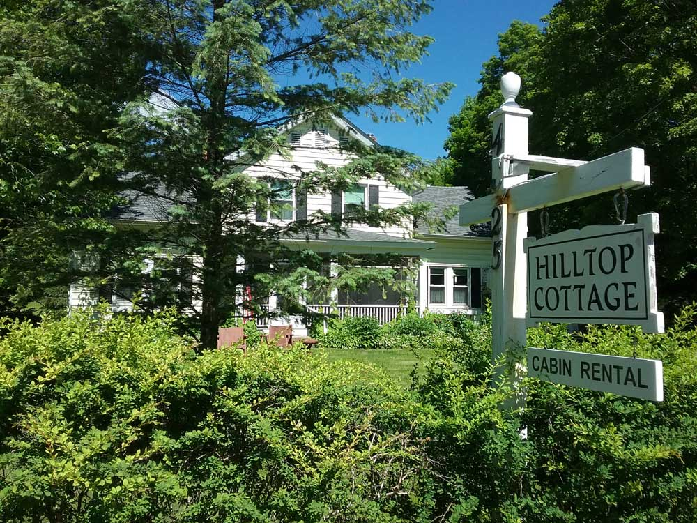 Hilltop Cottage Sign and House
