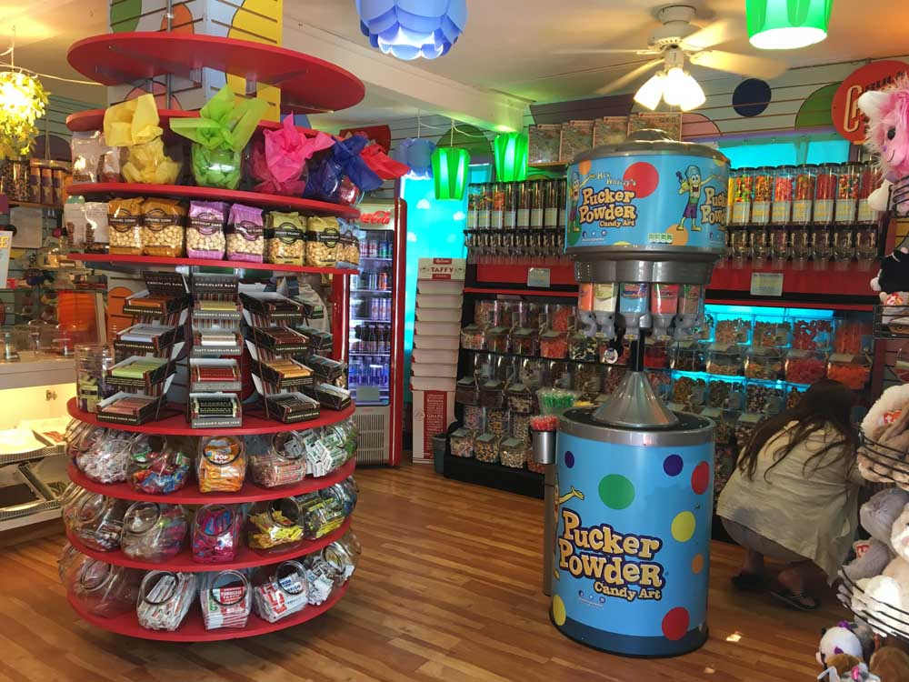 various candy displays within mrs. whizzy fizz popp's