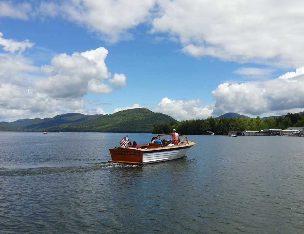 boating on lake george during beautiful day