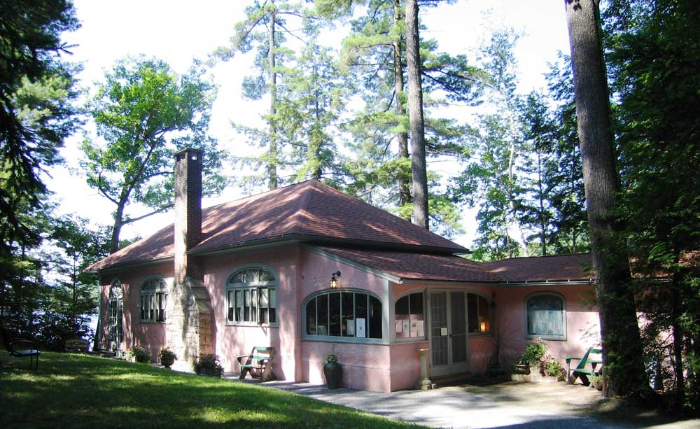 exterior of pink house with chimney