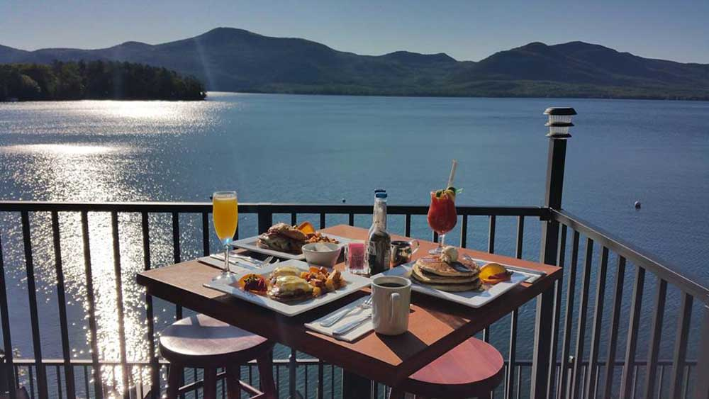 table of food on patio looking over lake george