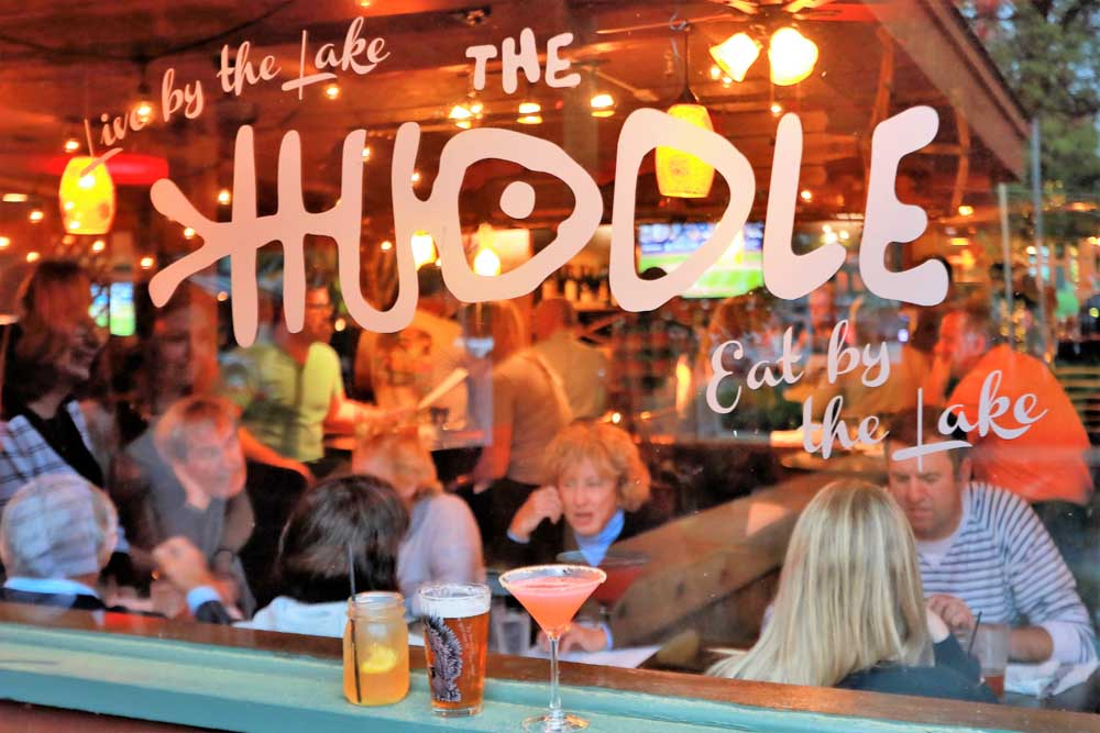outside looking in at the huddle kitchen and bar