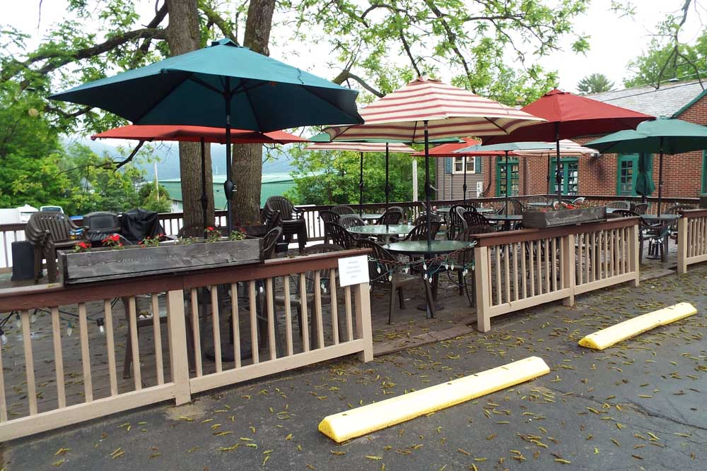 outside tables with umbrella covering