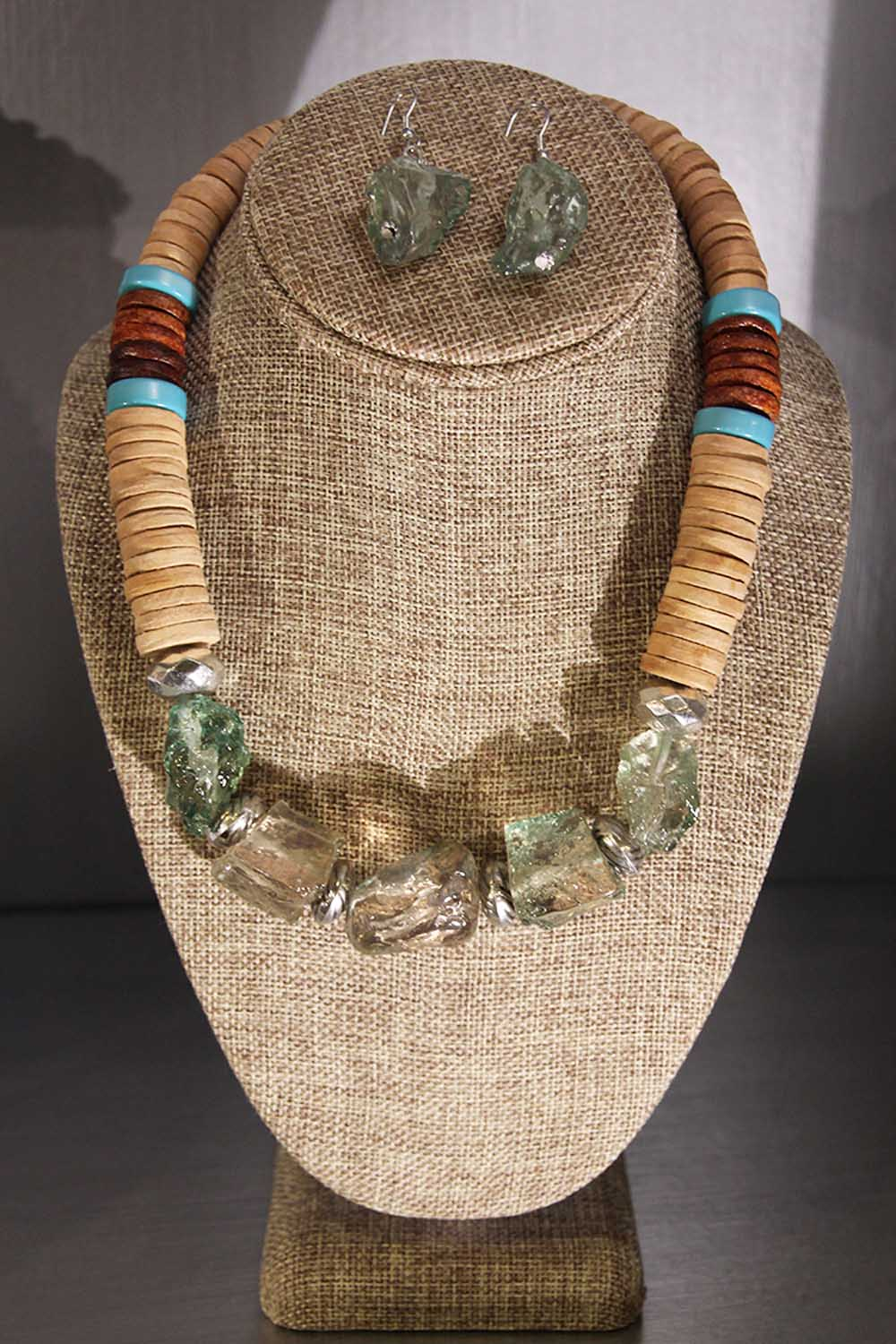 necklace and earrings on display
