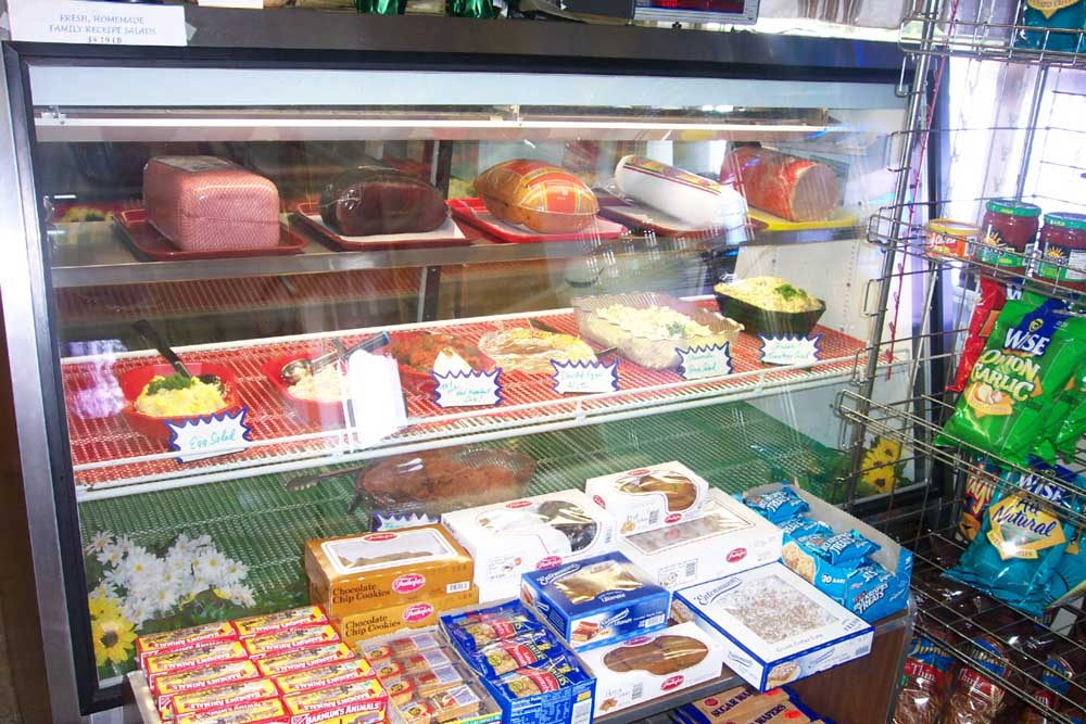 deli meats and sides behind glass
