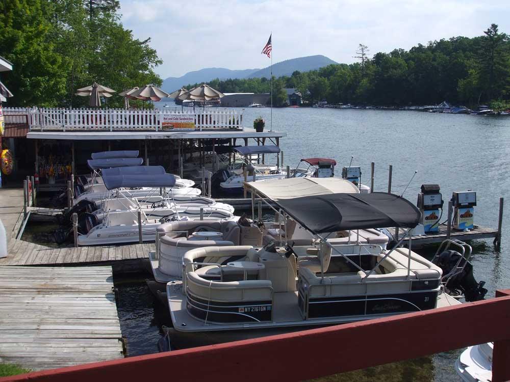 boats docked at waters edge marina