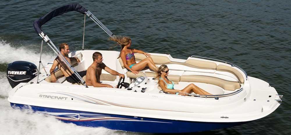 four people enjoying sunny cruise in boat