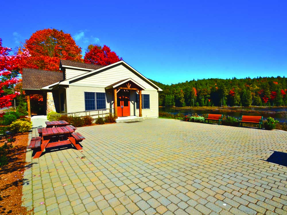 stone patio with building and picnic table