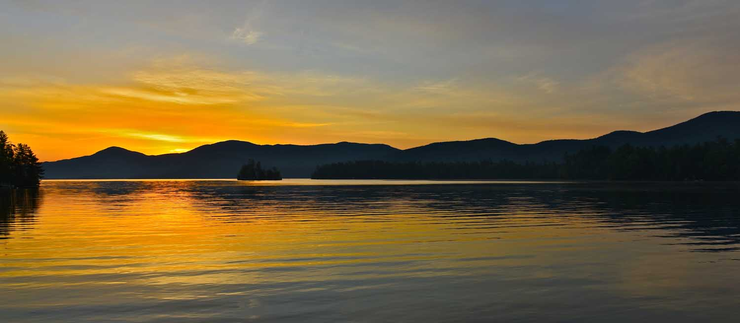sun setting over adirondack mountains