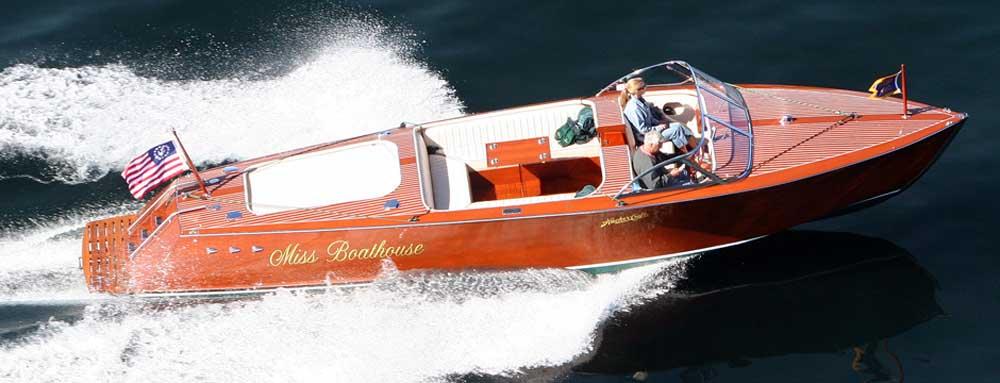 vintage speed boat cruises through water